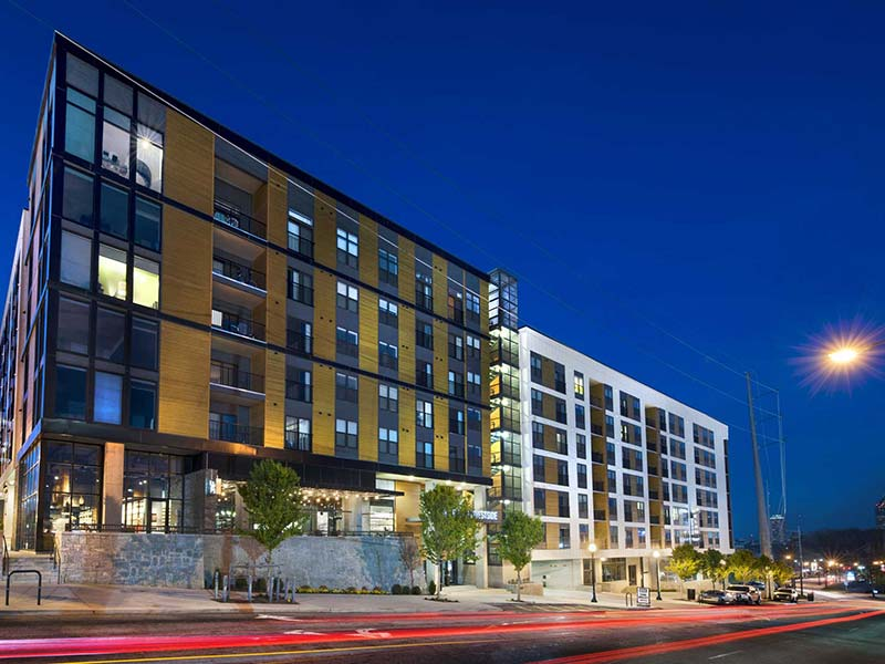 Cottonwood Westside street view at night showing leasing office entry side