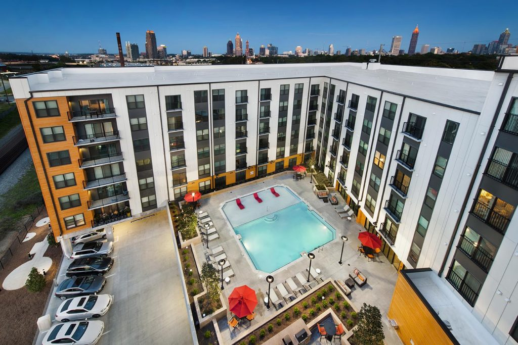 Cottonwood Westside aerial view showing Atlanta skyline and overlooking pool area