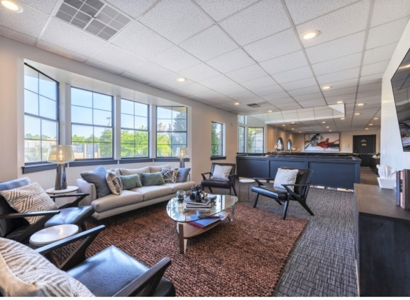 View of the Resident Lounge at Cottonwood Apartments, Showing Sitting Area, Window View, and Décor