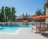 View of the Pool at Cottonwood Apartments, Showing Loungers, Cabanas, and Grilling Area with Pergola