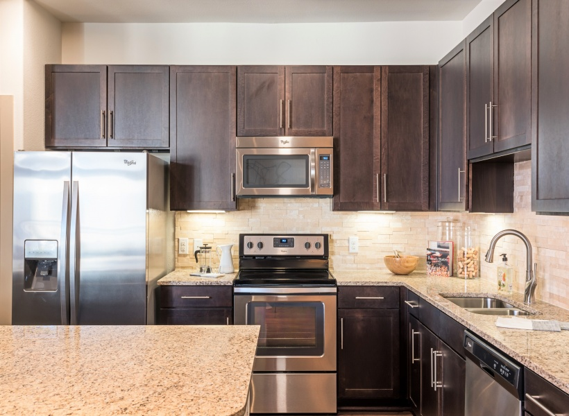 View of Kitchen, Showing Granite Counter Top, Island, and Stainless Steel Appliances at 3800 Main Apartments