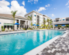 View of Pool Area at Cottonwood West Palm, Showing the Pool and Sun Deck and Lounge Chairs in the Distance.