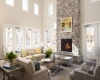 View of Resident Lounge, Showing Seating Area, Fireplace, and High Ceilings at Cottonwood One Upland Apartments