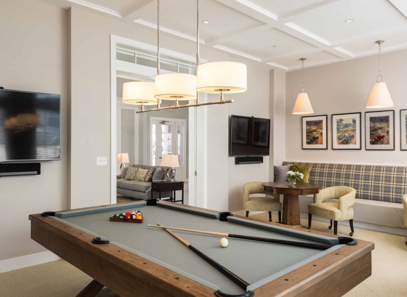 View of Billiards Lounge, Showing Game Table, Sticks, and Gathering Space at Cottonwood One Upland Apartments