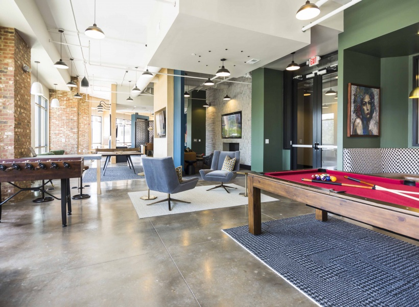View of Billiards Table, Seating ARea, and Open Space at Alexan Optimist Park Apartments
