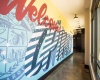 Bright, Colorful Mural in Hallway at Alexan Optimist Park Apartments