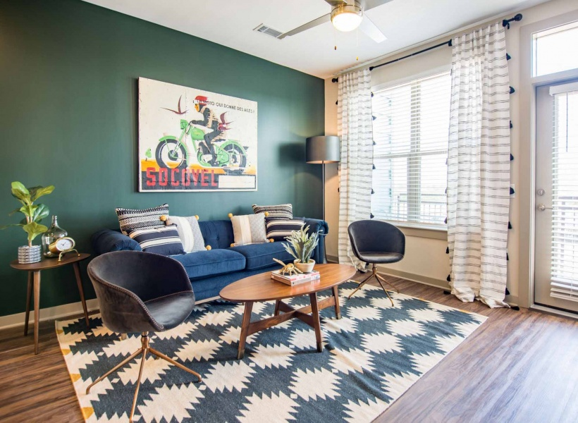 Rug, Couch, and Window View in Apartment Interior at Alexan Optimist Park Apartments