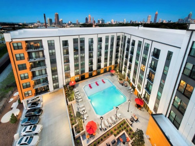 View of the Building Exterior at Cottonwood Westside Apartments, Showing Aerial View of Apartment Complex and Atlanta Skyline