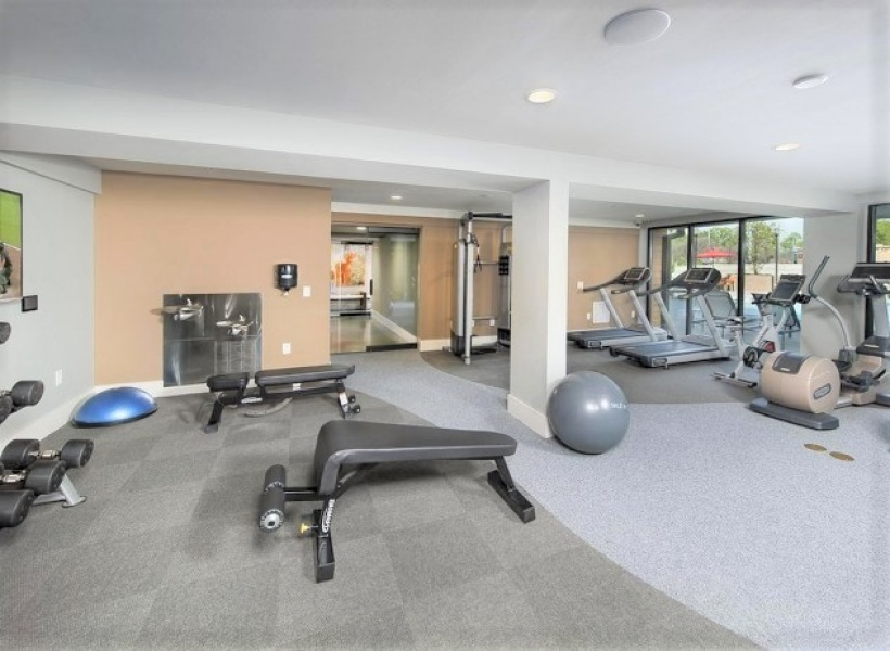 Cottonwood Westside Clubhouse fitness center, showing many machines and equipment that can be used by the residents