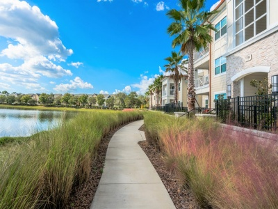 The Marq Highland Park Apartments Lake with Nature Trail
