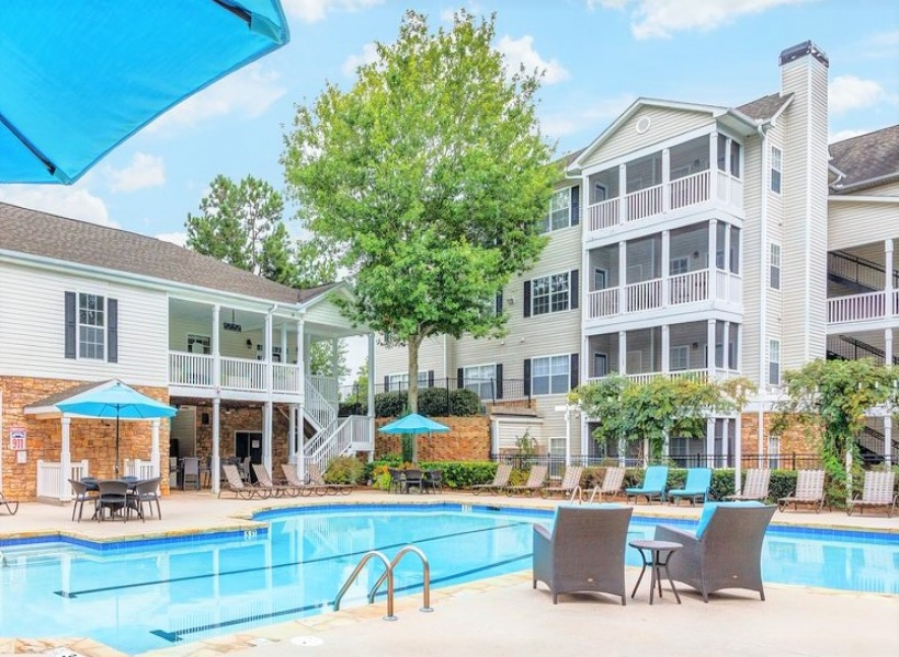 View of Pool Area, Showing Outdoor Furniture, Loungers, and Pergola at Summer Park Apartments