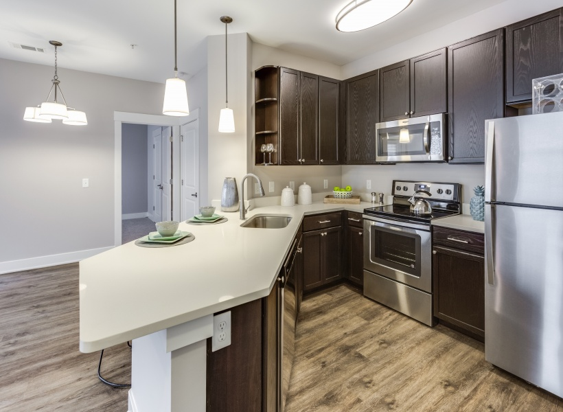 View of Kitchen, Showing Galley Kitchen, Stainless Steel Appliances, Laundry Room at Cottonwood Reserve Apartments