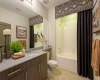 View of the Bathroom at Heights at Meridian Apartments, Showing Oversized Single Vanity and Granite Countertop
