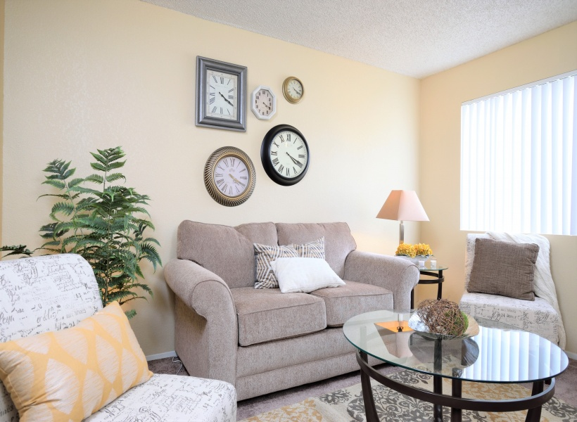 View of Furnished Living Room, Showing Seating Area, Carpet, and Décor at Camelot Apartments