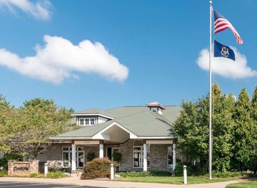 View of Leasing Center, Showing Building Entrance and Flag Pole Displaying the American Flag at Clearview Apartments
