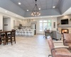 View of Clearview Apartments Clubhouse, with windows to look outdoors, fireplace, and large tv