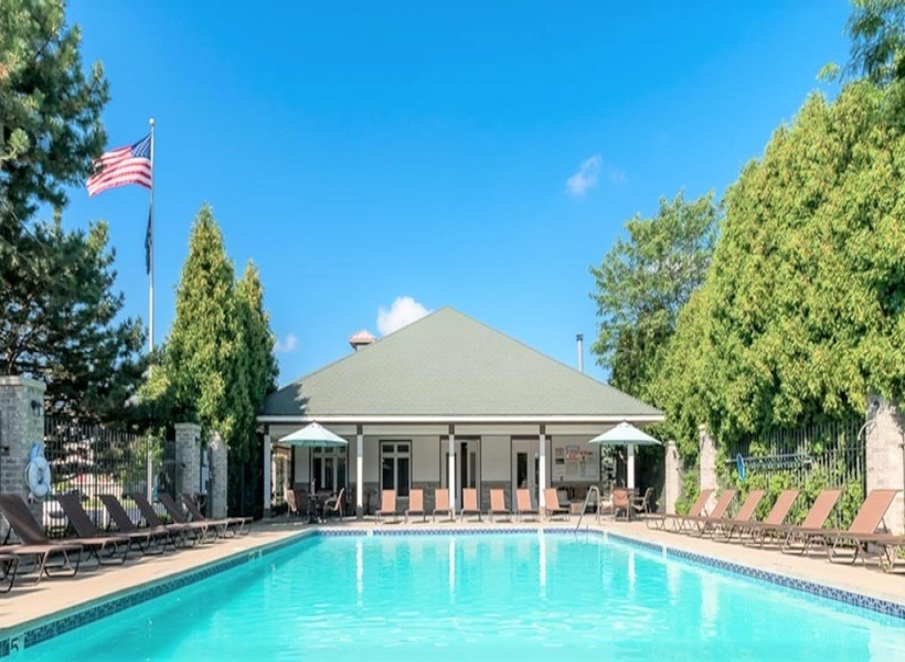 View of Resort-Style Pool, Showing Clubhouse Exterior, Lounge Chairs, Landscaping at Clearview Apartments