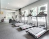 View of Fitness Center, Showing Treadmill, Ellipticals, and Stationary Bike at Plantations at Haywood Apartments