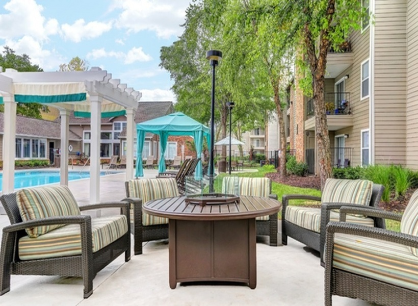 View of Pool Area, Fire pit, Cabanas, Pergolas, and Adjacent Resident Clubhouse at 1070 Main Apartments