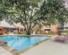 View of Pool Area, Showing Loungers, Grilling Areas, and Building Exteriors at 4804 Haverwood Apartments