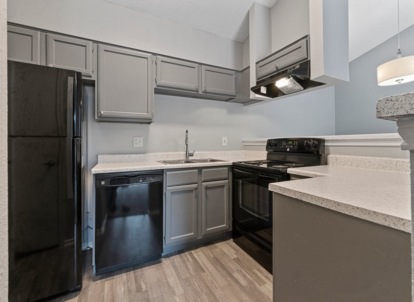 View of Renovated Apartment Interior, Showing the Kitchen at 4804 Haverwood Apartments