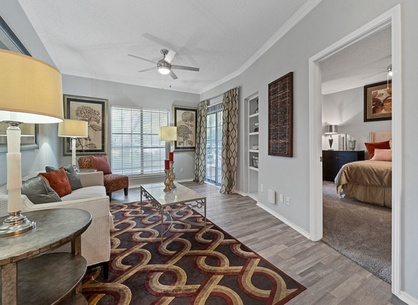 View of Renovated Apartment Interior, Showing Living Room With furniture and a ceiling fan, as well as a view out to the balcony at 4804 Haverwood Apartments