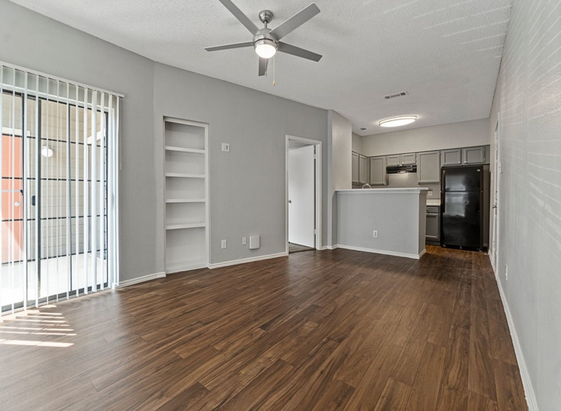 View of Renovated Apartment Interior, Showing Living Room With furniture and a ceiling fan, as well as a view of the kitchen at 4804 Haverwood Apartments