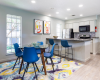 View of Clubhouse Kitchen Showing Table and Chairs, Bar Seating, and a Kitchen Appliances at Solara Apartments