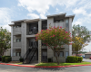 View of Three Story Exterior Apartment Building With Tree Out Front at Soloara Apartments