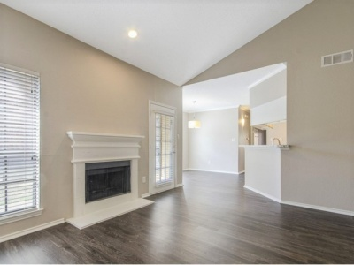 Spring Pointe fireplace and wood-inspired flooring