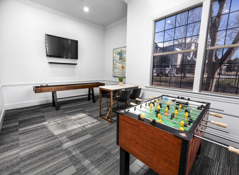 View of Resident Game Room Showing Foosball Table, Seating, and other Games at Stonebriar of Frisco.