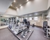 View of The Arbors of Las Colinas Fitness Center, showing large room, and many cardio machines