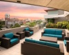 View of Rooftop Lounge, Showing Outdoor Furniture, Landscaping, and Grilling Lounge at Cottonwood Bayview Apartments