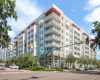 View of Cottonwood Bayview Apartments located in St. Petersburg, Florida, showing streetside view, landscaping around the building, and more!