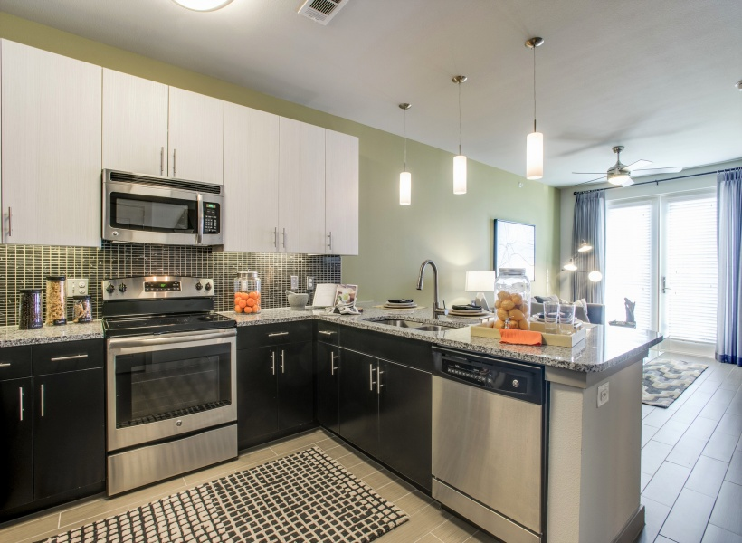Routh Street Flats chef-inspired kitchen with granite countertops