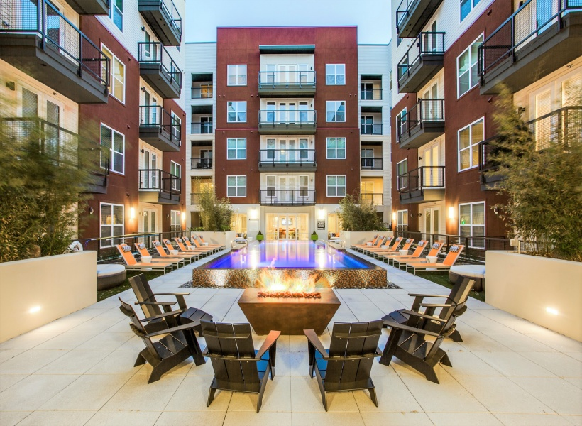 View of Rooftop Lounge, Showing Fire Pit, Outdoor Furniture, and Views of Uptown and Downtown Dallas at Routh Street Flats Apartments